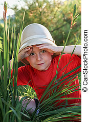 Boy explorer in a Pith helmet
