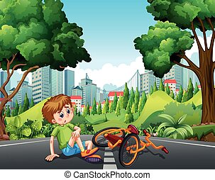 Boy falling off the bike on the street
