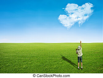 boy field clouds in shape of heart