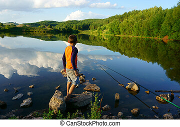 boy fishing on the lake