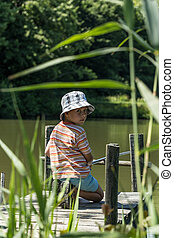 Boy fishing - Photo of boy fishing on the lake