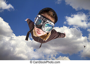 Boy flying, daydreaming he?s a pilot - Boy dressed up in ...