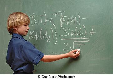 Boy Genius - Nine year old boy doing advanced math on a...