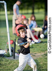 Boy Getting Ready to Hit a Home Run - Young Boy Getting...
