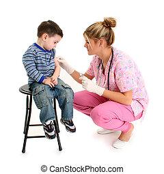 Boy Getting Shot - Nurse giving small boy a shot.