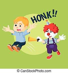 boy getting surprise by clown
