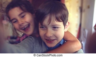 boy girl hugging shout brother self and sister happiness -...