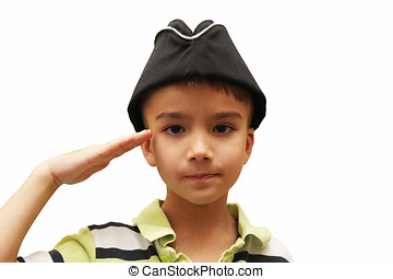 Boy gives a military salute