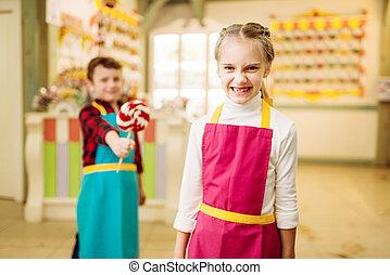 Boy gives handmade lollipop to stubborn girl