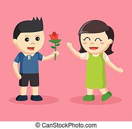 boy giving flower to girl