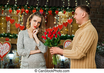 boy giving flowers to his girl on valentine's day