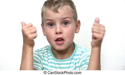 Boy giving thumbs up OK