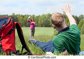 Boy greeting girl on a meadow