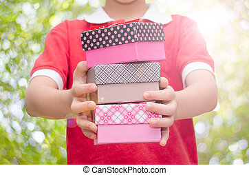 Boy hands holding and giving gift boxes