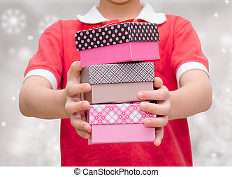Boy hands holding and giving gift