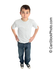 boy hands on hips - A pre teen child standing with hands on...