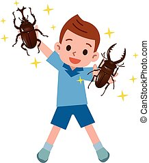 Boy happy to capture the beetles and stag beetles