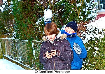 boy has fun in winter landscape in snow