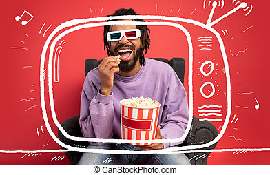 Boy has fun watching a film. Concept of entertainment and streaming tv