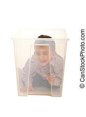 Boy having fun in a box