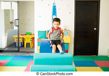 Boy having fun in an obstacle course