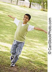 Boy having fun in park