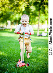 Boy having fun on the grass