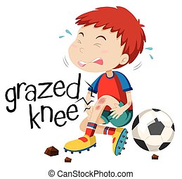 Boy having grazed knee