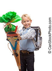 Boy having his first schoolday and showing his
