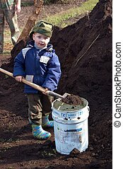 Boy helps fertilize the land