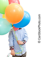 Boy hiding behind a bunch of balloons isolated on white background.