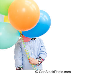 Boy hiding behind a bunch of balloons isolated on white background. Copyspace for text.