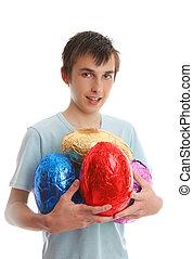 Boy holding 4 large easter eggs