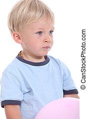 Boy holding a balloon
