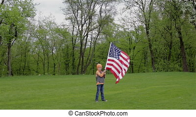 Boy holding a banner of the US