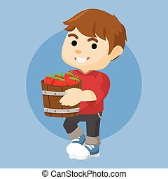 boy holding a bucket of strawberry