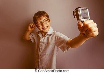 boy holding a camera