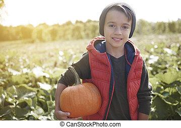 Boy holding a halloween pumpkin