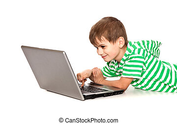 Boy holding a laptop