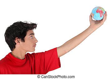 Boy holding a mini globe