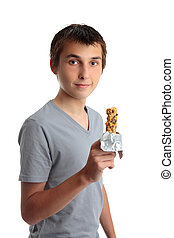 Boy holding a nutritional snack bar - A young teen boy...