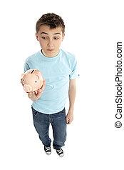 Boy holding a piggy bank money box