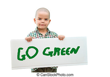 """boy holding a sign """"go green"""" in the hands. In light background."""