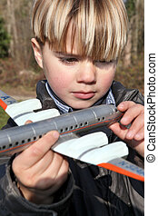 Boy holding a toy plane