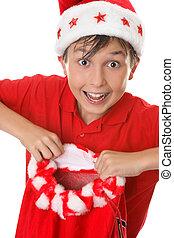 Boy holding a toy sack