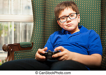 Boy holding a video game controller