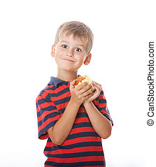 Boy holding an apple  isolated on white background