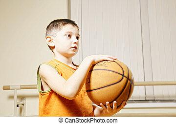 Boy holding basketball