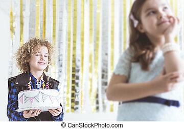 Boy holding birthday cake