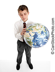 Boy holding blow up ball of the Earth world - A student...